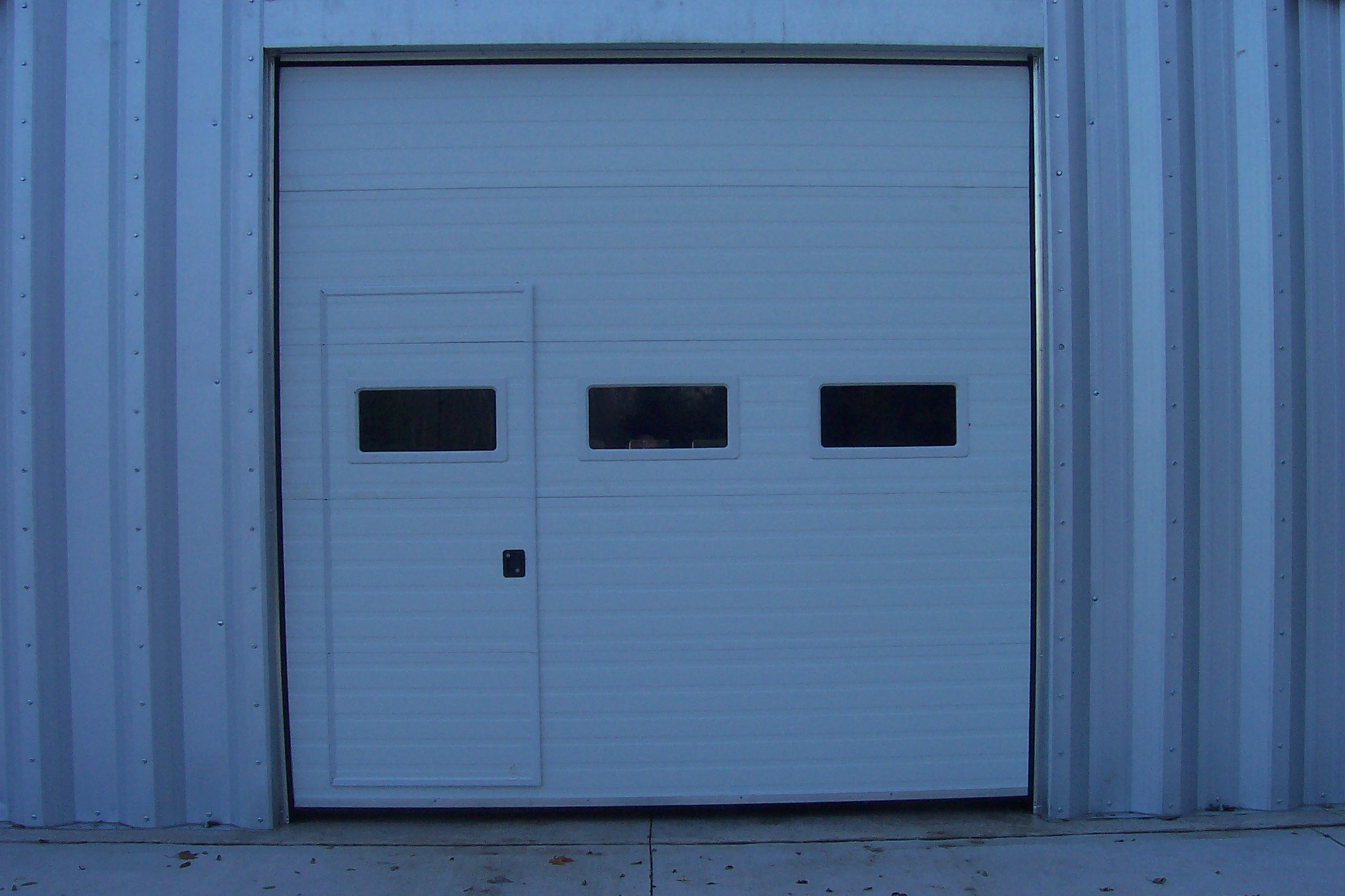DGH Doors Walk Thru Garage Door